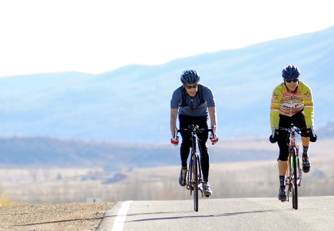 Doug Demusz, left, and J.R. Thompson, ride down county road 14 south of Steamboat Springs on Saturday. The road is among many that could be used when the Quiznos Pro Challenge road bike stage race stops in Steamboat Springs.