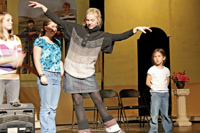 "Director Heather Dahlberg, middle, teaches dance moves to Kaytlin Herring, left, Kellie Looper and Briana Woods during a recent rehearsal of the school's production of ""The Sound of Music."" This is Dahlberg's first year in the Moffat County School District. She said her goal is to make the MCHS musical/theater program better than it has ever been."