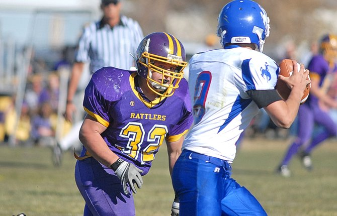 Little Snake River Valley's Jacob Ready chases down Kaycee  quarterback James Caro during Saturday's 1A six-man football playoff game in Baggs, Wyo. The Rattlers won, 42-12, earning a trip to the state championship game.