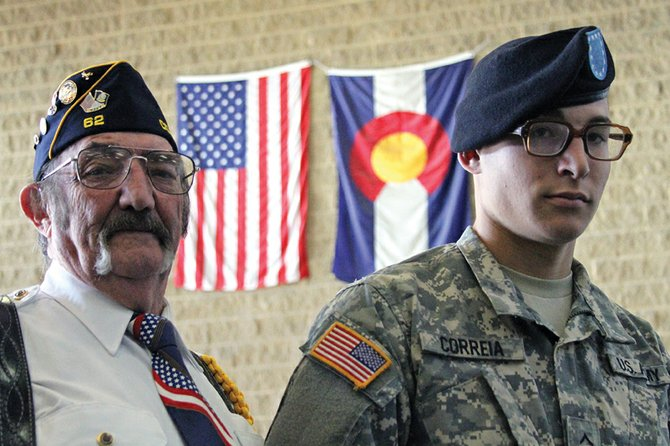 "Dylan Correia, right, stands Thursday with his grandfather Kenneth ""Howdy"" Davis at Moffat County High School after Veterans Day ceremonies had concluded. Correia, 19, who grew up in Craig, but graduated from Grand Junction High School, will start active duty service in the Army on Nov. 19. Correia said Veterans Day is quickly becoming one of his favorite holidays."