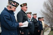 Members of Veterans of Foreign Wars Post 4265 participate in a flag dedication ceremony Saturday at Thunder Rolls Bowling Center in Craig.