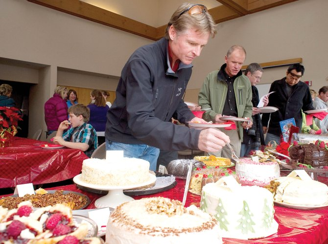 Robert Ames samples a few of the many tasty desserts that were a part of the 2010 Holiday Dessert Bake-Off on Monday at the Steamboat Pilot & Today.