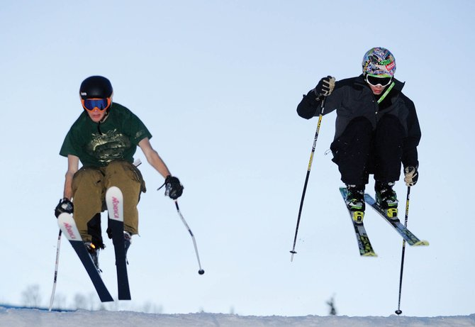 Chris Barounos, left, and Stefan Kowynia train in March at Howelsen Hill with the Steamboat Springs Winter Sports Club's ski cross program. Several ski cross events are coming to Steamboat Ski Area in January.