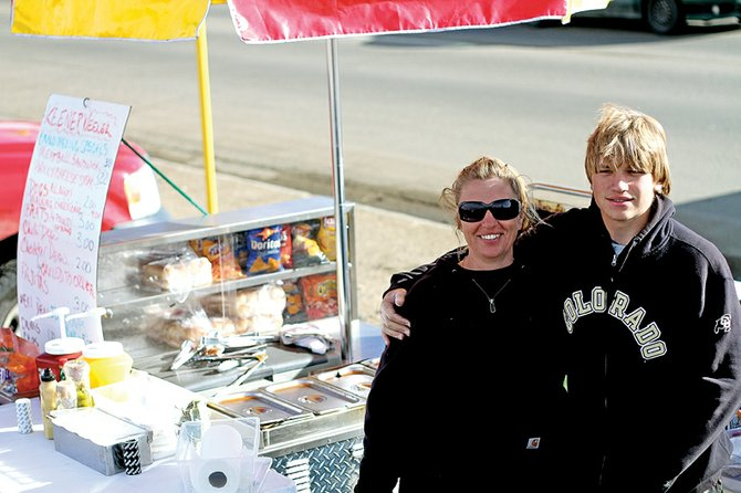 Dawn Vezie, 49, left, stands Friday with her son, David, 16, next to The Keener Weener hot dog stand, which Dawn has operated since October in the parking lot of the Centennial Mall. Dawn said the idea to start the business was a combination of an employment history in the food service industry and an entrepreneurial spirit.