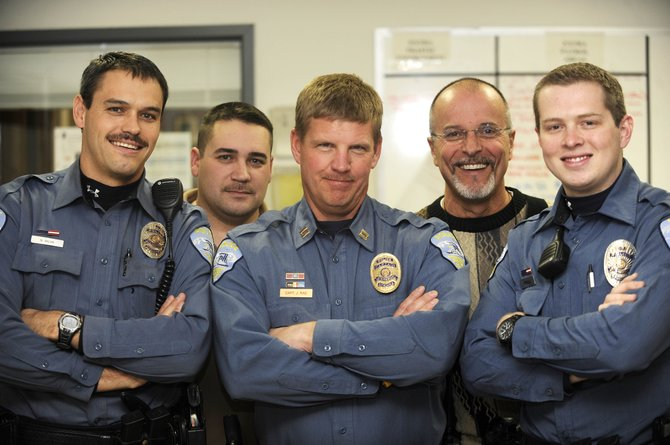 A mustache contest at the Steamboat Springs Police Department began Nov. 1 and will serve as a fundraiser for Sgt. Dale Coyner, who is battling cancer. Pictured are, from left, Sam Silva, Tom Munden, Joel Rae, JD Hays and Evan Driscoll.