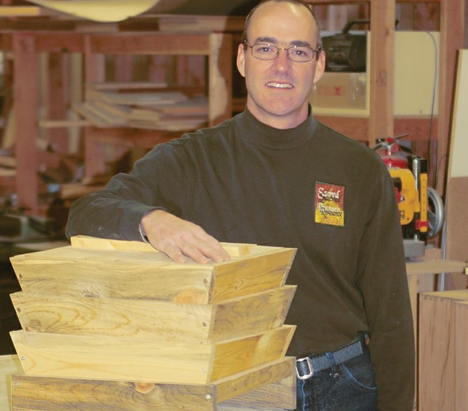 Chris Bradley makes custom worm composting bins from native beetle-killed pine for composting indoors throughout the winter.
