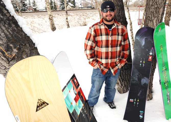 Skis Haus' Pete Normand shows off some of the shop's top snowboards, just in for the arriving ski and snowboard season. From left, the Jones Flagship, $500; K2 Slayblade, $550, K2 Fling, $400; and Burton Déjà Vu V-Rocker, $400, represent a wide variety of options for boarders looking for a new ride.
