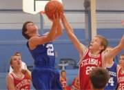 Eighth-grader Phillip Chadwick goes in for a lay-up during Craig Middle School's Thursday basketball game against Steamboat Springs, the final home game of the season. The eighth-grade A-team beat the Sailors, 43-25. They also won, 41-16, in their Saturday game against Rangely.