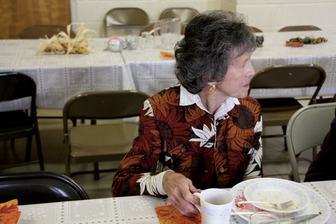 Rosemary Crosthwaite has some post- dinner conversation Sunday at First Congregational United Church of Christ. About 40 people attended the annual Thanksgiving event.