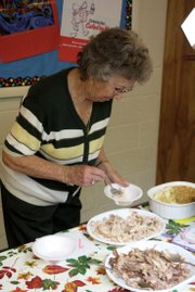 Joann Stoddard serves herself turkey Sunday during the annual Thanksgiving dinner at the First Congregational United Church of Christ. A 28-pound turkey served all members of the congregation, plus several members of the community.