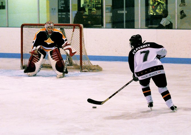 Lani Cleverly, member of the Craig Puck Ewes women's hockey team, approaches the goalie for the Vail Twin Peaks in a 2008 game. The Puck Ewes dropped a game against Vail on Saturday, 7-2, at the Moffat County Ice Arena. The team's season record stands at 0-3.