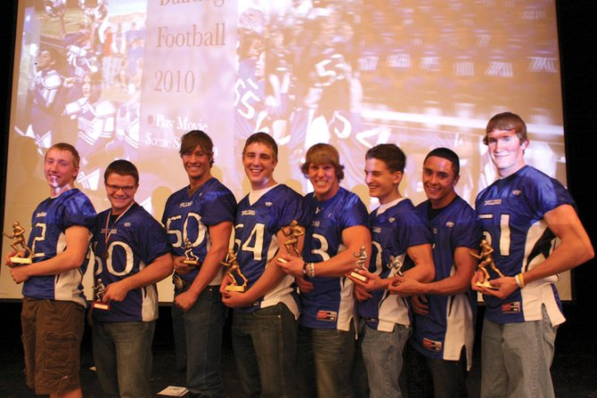 From left, Moffat County varsity football players Bubba Ivers, Gage Spears, Dario Georgiou, Angelo Raftopoulos, Brady Conner, Zach Raftopoulos, Miguel Molina and CJ Walt pose with their Western Slope trophies during Monday night's football awards banquet. Sophomore Ivers and seniors Angelo, Conner and Walt received 3A Western Slope League all-conference honors, while seniors Spears and Zach and juniors Georgiou and Molina were honorable mentions.