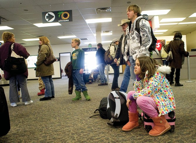 Sarah Ashworth, right, waits for the rest of her luggage to arrive at Yampa Valley Regional Airport on Monday. Airport officials don't expect the new techniques being used by the Transportation Security Administration to affect travel this week.