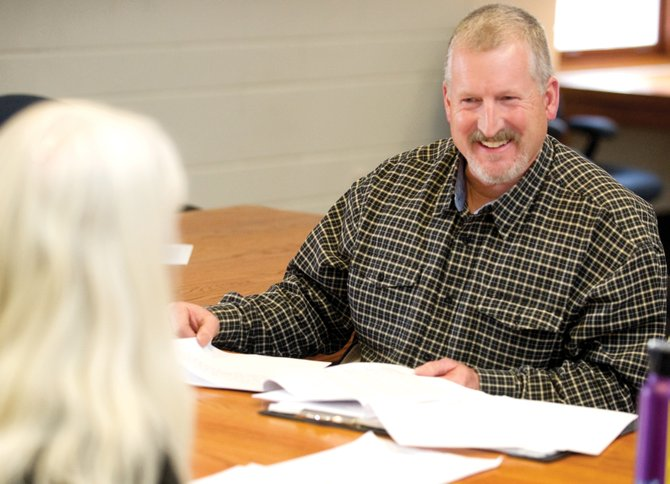 Sheriff-elect Garrett Wiggins sits in front of the Routt County Board of Commissioners on Monday afternoon to request his choice for undersheriff, Joe DeAngelo, to come on at a higher pay level.