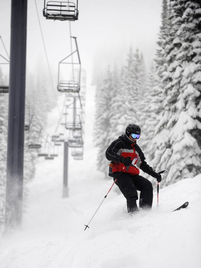 Boulder resident Colin Bovet skis Wednesday morning under the Bar UE lift at Steamboat Ski Area. Blizzard conditions were predicted for Scholarship Day, the first day of the 2010-11 season, but the wind was mild and the sun peeked from behind the clouds by midmorning.