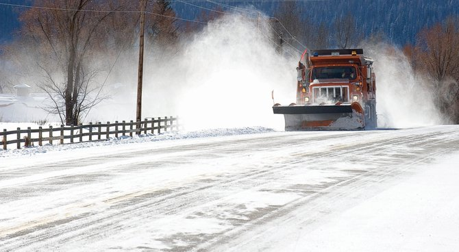 A state plow truck clears snow from U.S. Highway 40 on Wednesday morning. A storm, which was expected to bring heavy snow and blizzard conditions, stalled in southern Colorado before arriving in Routt County. The forecast is calling for cold but clear weather for the next few days.