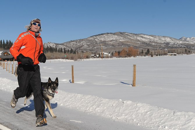 Chilling temperatures did little to stop Steamboat runner Dave Carley and his dog, Hazel, on Thursday at the second annual Turkey Trot in Steamboat Springs.