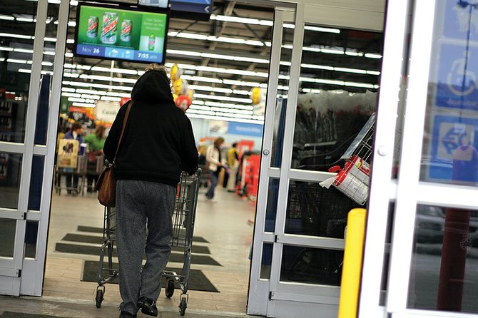 A resident walks through the doors of Walmart early Friday morning during a Black Friday sale. Regional economist Scott Ford said he expects holiday spending to be about the same as it was last year in Moffat County. Consumers, Ford contends, are developing a bit more confidence in spending recently, which could help local retail sales.