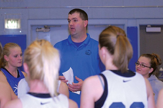 Matt Ray, Moffat County High School girls basketball coach, discusses strategy with his team during a recent practice. The Bulldogs scrimmaged Coal Ridge and host Rifle on Saturday to get some competitive play in before the start of the season.