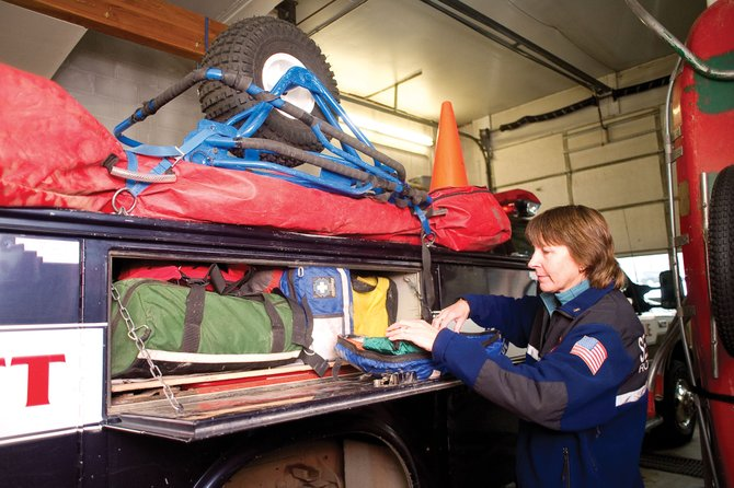 Routt County Search and Rescue Incident Commander Kristia Check-Hill stays busy Monday making sure the truck is ready for the next mission. Search and Rescue responded to three missions Sunday and has had 73 calls for service this year.