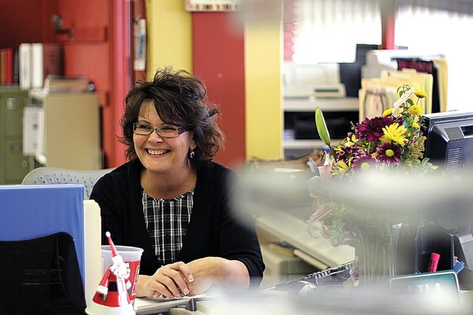 Lila Herod, Moffat County Clerk and Recorder-elect, shares a laugh Tuesday in the clerk's office inside the Moffat County Courthouse. In April, Herod, then the county elections supervisor, resigned from her position so she could remain eligible as a candidate for clerk and recorder due to the federal Hatch Act. She re-joined the staff Nov. 23, after an about eight-month absence.