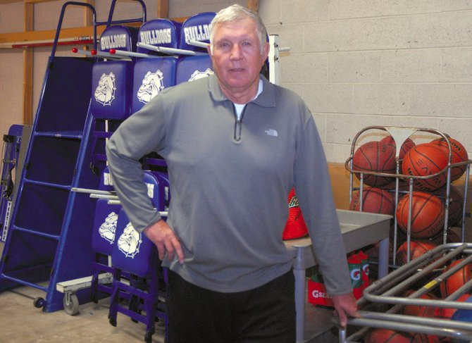 Jim Loughran prepares for practice Tuesday afternoon in the equipment room of the Moffat County High School gym. Loughran, the new boys freshmen basketball coach, worked at the school for more than 20 years as a teacher, athletic director and coach before retiring in 2006.