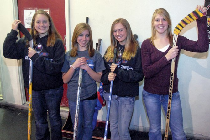 From left, Taylor Shrode, Sarah White, Ripley Bellio and Kelsie Pomeroy hoist their hockey sticks at the Moffat County Ice Arena. MCHS sophomores Shrode and Pomeroy are members of the Bulldogs club team, while freshmen Bellio and White play on the Craig Cougars Bantam team. Bellio and Shrode also play on the Colorado Springs Amateur Hockey Association's girls team.
