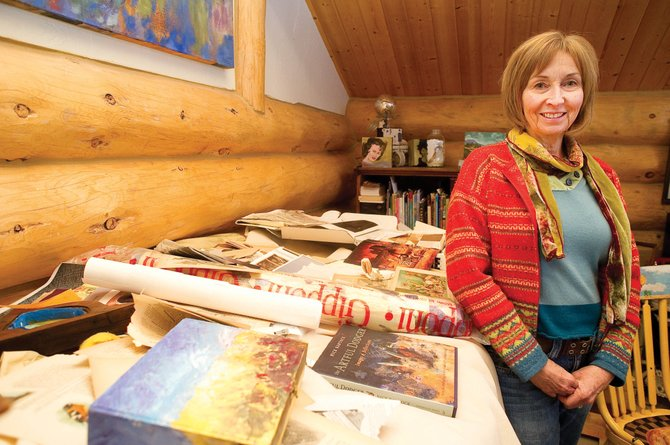 A day bed inside Mary Beth Galer's studio on Lynx Pass serves as catchall for the items she uses in her art.