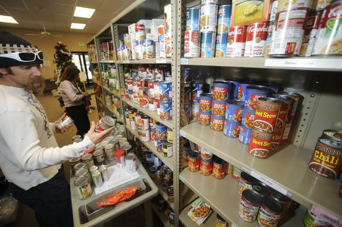 LIFT-UP of Routt County volunteer Danny Tebbenkamp stocks shelves Friday. LIFT-UP Food Bank serves as an important resource for individuals and families struggling to make ends meet, said Vickie Clark, director of the Routt County Department of Human Services.