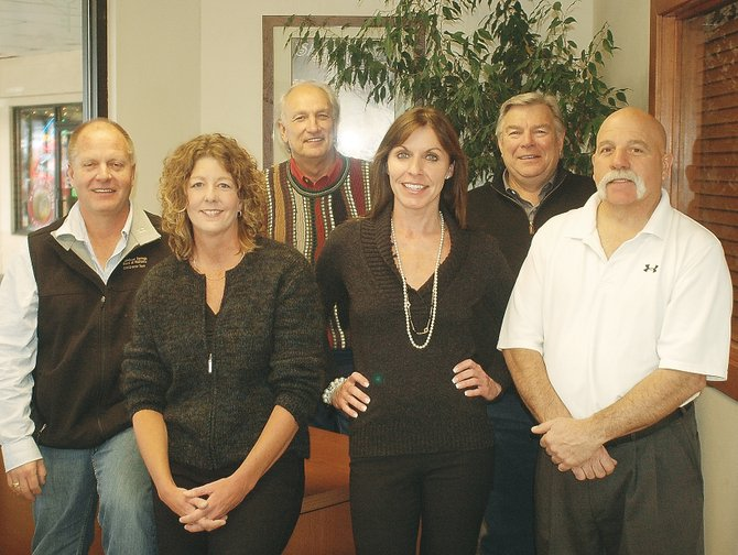 Managing Broker Jim Hansen, from left, Sue Weber, W.C. White, Joan Connelly, Bill Starkey and Joe Pete LoRusso are among the partners in Keller Williams of Steamboat, formerly Old Town Realty.
