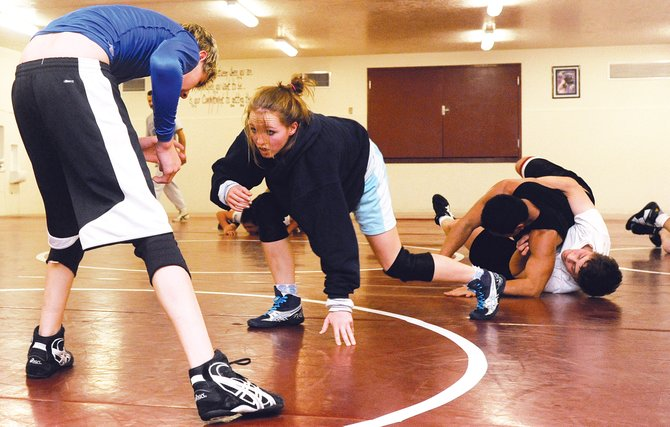 Soroco junior Lauryn Bruggink faces off against freshman Colton Martindale on Friday as the Rams go through their final practice before the start of the regular season. Bruggink won twice at state a year and set her eyes on a 103-pound state championship this season.