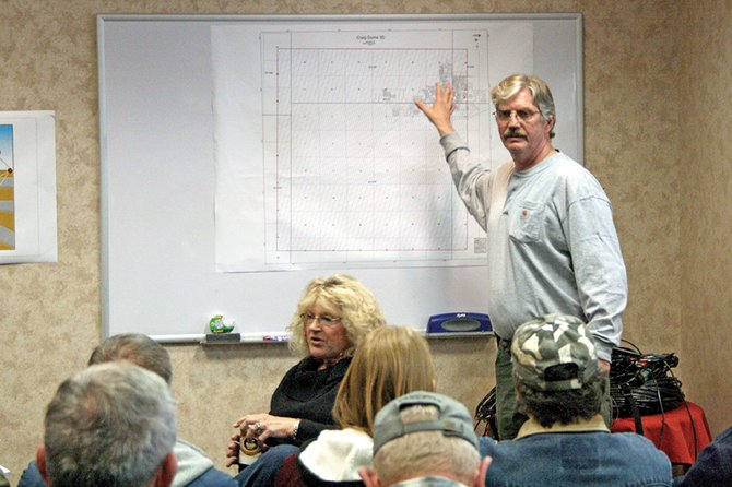 Brent Jacobsen, a project manager for Geokinetics, points to a property map of Craig during a question-and-answer session Saturday at the Holiday Inn of Craig. Geokinetics intends to perform a geologic survey of Craig and parts of Moffat County, and is seeking permission from residents to place seismic sensors on private land. The survey could identify pockets of oil and natural gas.