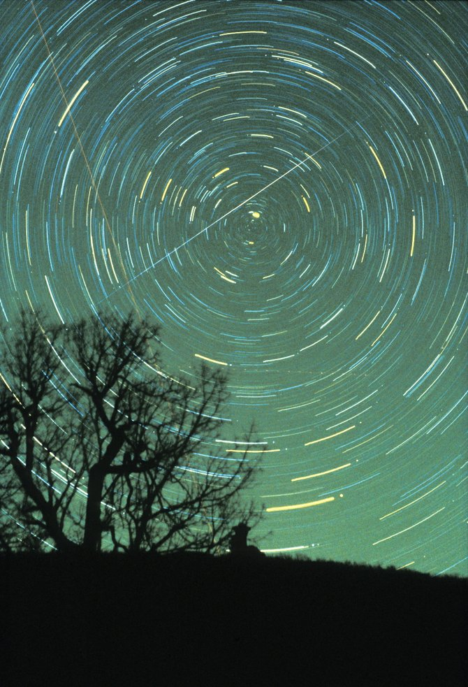 A bright Geminid meteor slices across the middle of this one-hour time exposure taken from Brasstown Bald Mountain in northern Georgia on Dec. 14, 1985. Twenty-five years later, the annual Geminid meteor shower continues to get stronger and better. The peak of this year's Geminid shower is expected before dawn Tuesday.