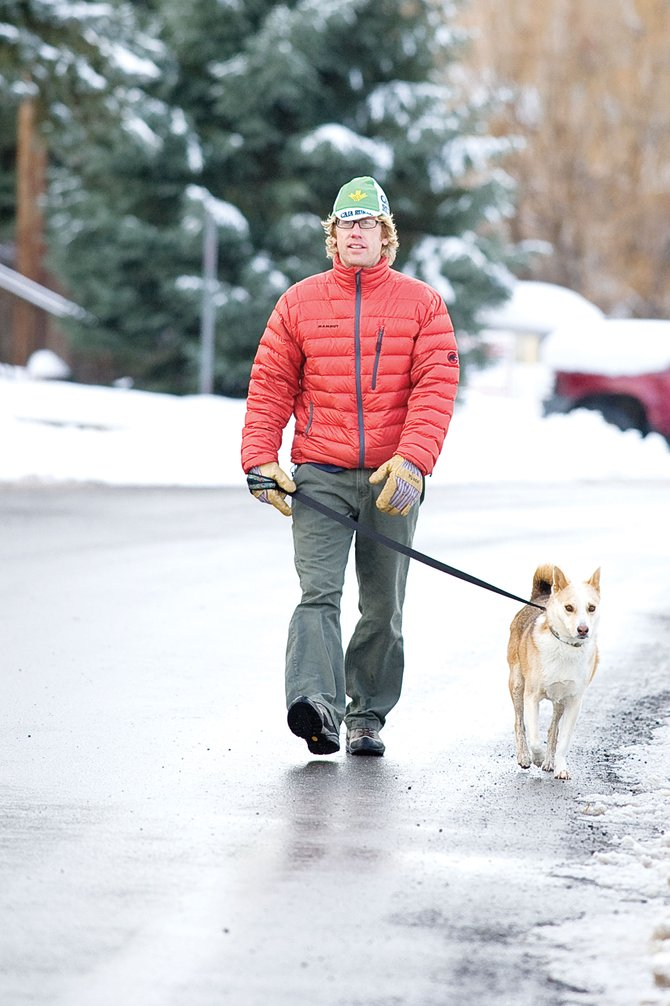 Steamboat Springs resident Brock Webster walks his dog in downtown Steamboat Springs.
