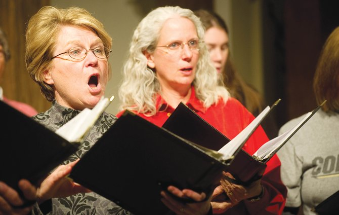 Singers Nancy Kramer and Valerie Davia rehearse with the Steamboat Chamber Singers on Wednesday evening at the St. Paul's Episcopal Church. The group will perform at 7 p.m. Saturday and 3 p.m. Sunday at the church.