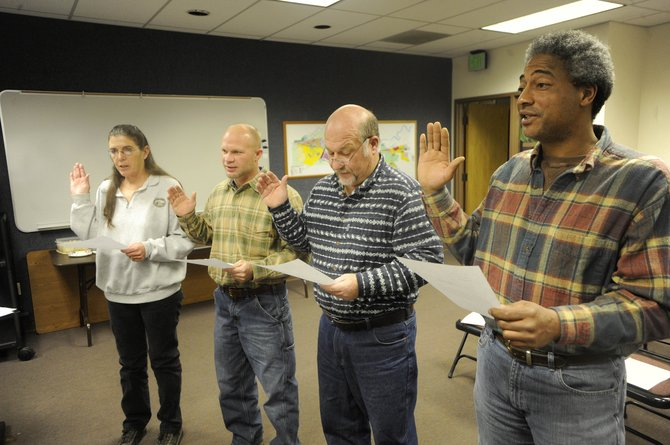 Hayden Town Council members, from right, Tim Redmond, Jim Haskins, Dallas Robinson and Lorraine Johnson are sworn in during Thursday night's meeting.