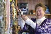 Craig resident Sharon Miller, 66, stands Thursday in her store, Crystal Sanctuary, which specializes in beads, fossils, crystals, fossils and readings. Miller, who has lived in Craig for about two years, said she wants the store to be a calm place of learning and healing for people in the community.