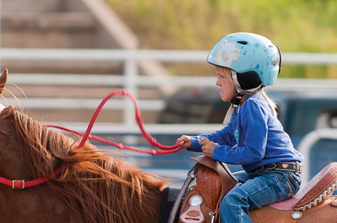 Jacey Matt puts on her game face during a Routt County Gymkhana Club event in Steamboat Springs this summer. The Gymkhana Club hosts competitive equestrian events for local families.