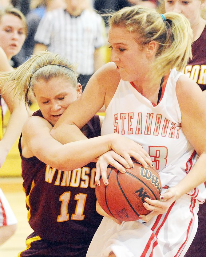 Steamboat's Eryn Rinck fights with Windor's Aimee Jo Harris for a rebound Thursday during the first round of the Steamboat Springs Shoot-Out at Steamboat Springs High School. After a lackluster first half, the Sailors blew past the Wizards, setting up a semi-final showdown at 6:30 p.m. today against Fossil Ridge.
