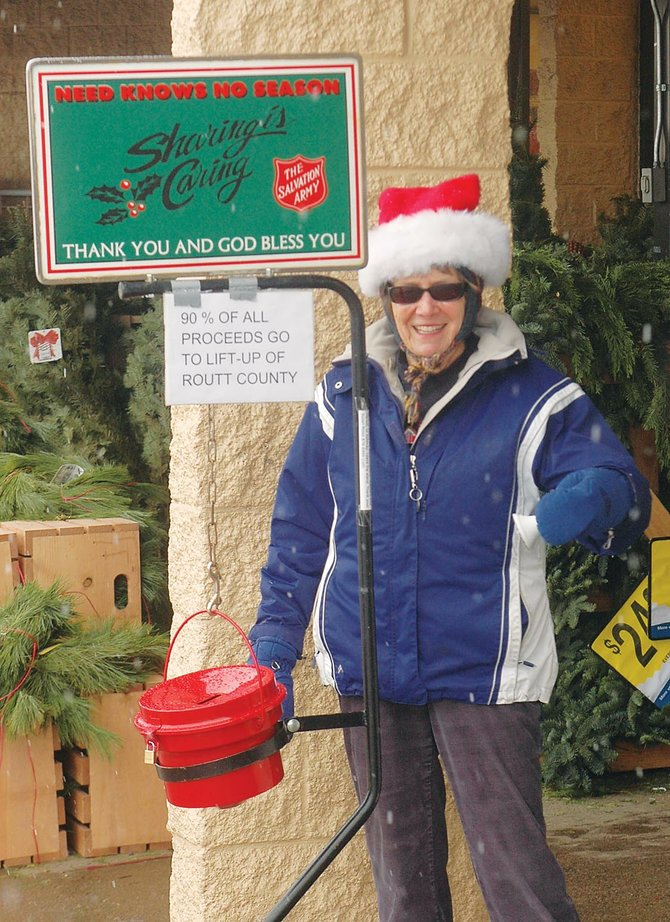 Jane Romberg rings the bell for The Salvation Army outside City Market on Friday.