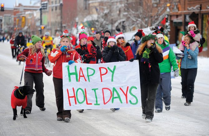 The staff from Creekside Cafe marches in last year's Merry Mainstreet parade. This year's event starts at 5 p.m. Saturday in downtown Steamboat Springs and includes expanded offerings such as games.
