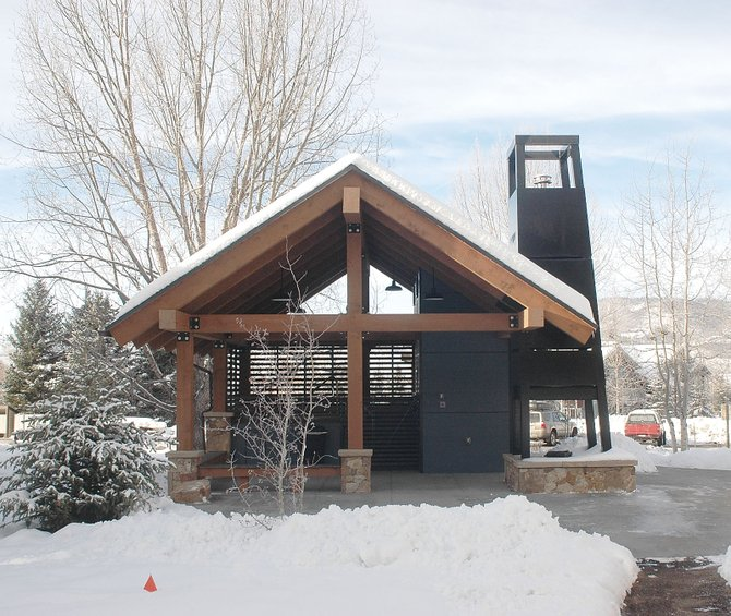 The new spa facility and outdoor fireplace at the 30-year-old Shadow Run condominium complex provides a preview of materials and designs that could be incorporated into a future upgrade of the buildings' exteriors.