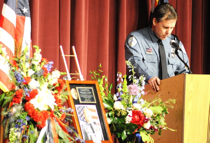 Steamboat Springs Police Department detective Nick Bosick pauses while speaking at the memorial service for Sgt. Dale Coyner on Sunday. Coyner served with the Police Department since 1998. He died in his sleep early Dec. 4 after battling esophageal cancer following a diagnosis in summer.