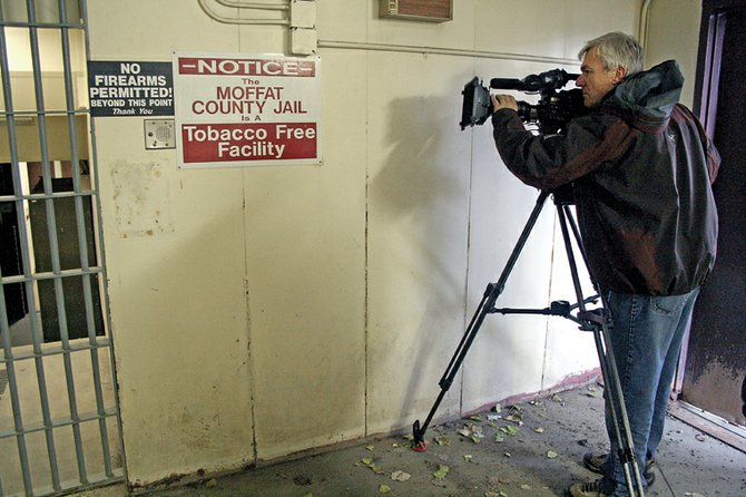 "Freelance photographer Carl Filoreto, of Golden, shoots footage Tuesday in the old jailhouse near the Moffat County Courthouse. Filoreto is in Craig on assignment for an upcoming Dateline NBC special. The special, tentatively titled ""Heaven's Rain,"" recounts the story of two fugitives who were apprehended north of town in 1979."