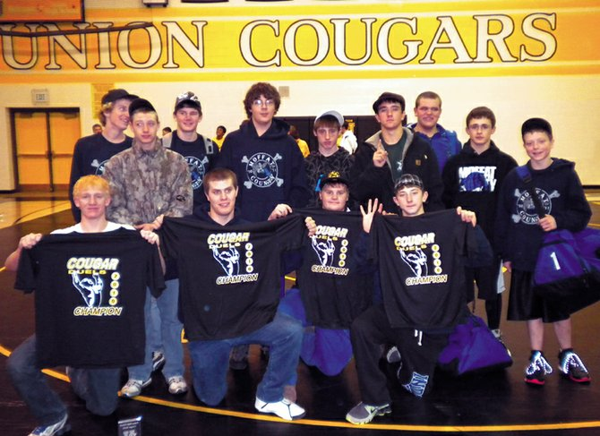 Moffat County High School wrestling team members show off their championship T-shirts from the Union Duals on Dec. 10. The Bulldogs finished 4-1 in duals to win the team trophy.