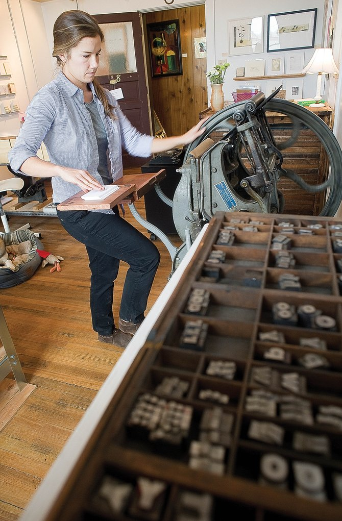 Christie Ginanni Stepan operates her 120-year-old Golding Pearl letterpress at her new business, Fancy Ink Press. Ginanni Stepan creates hand-printed cards and invitations as well as fine art.