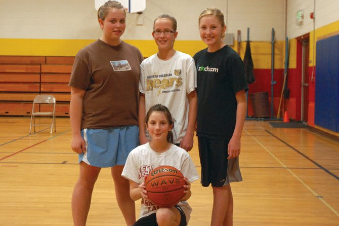 Competitors in the girls age 12 to 13 bracket of Saturday's Craig Elks Lodge No. 1577 Hoop Shoot contest are, back row, from left: Alexi Goodnow, Josey King, and Mattie Jo Duzik. Hannah Walker is shown kneeling with the ball. The four of them have played basketball together for several years and enjoy the friendly competition of the Hoop Shoot. On Saturday, King won first, Goodnow second, Walker third and Duzik fourth. King will compete at the district contest Jan. 22 at Sandrock Elementary School.