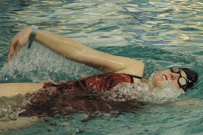 Eryn Leonard, a Moffat County High School swimmer, works on her backstroke in the MCHS pool during a girls swimming team practice. On Saturday, the team competed in the League Relays at Mesa State College, placing fifth out of 11 teams overall.