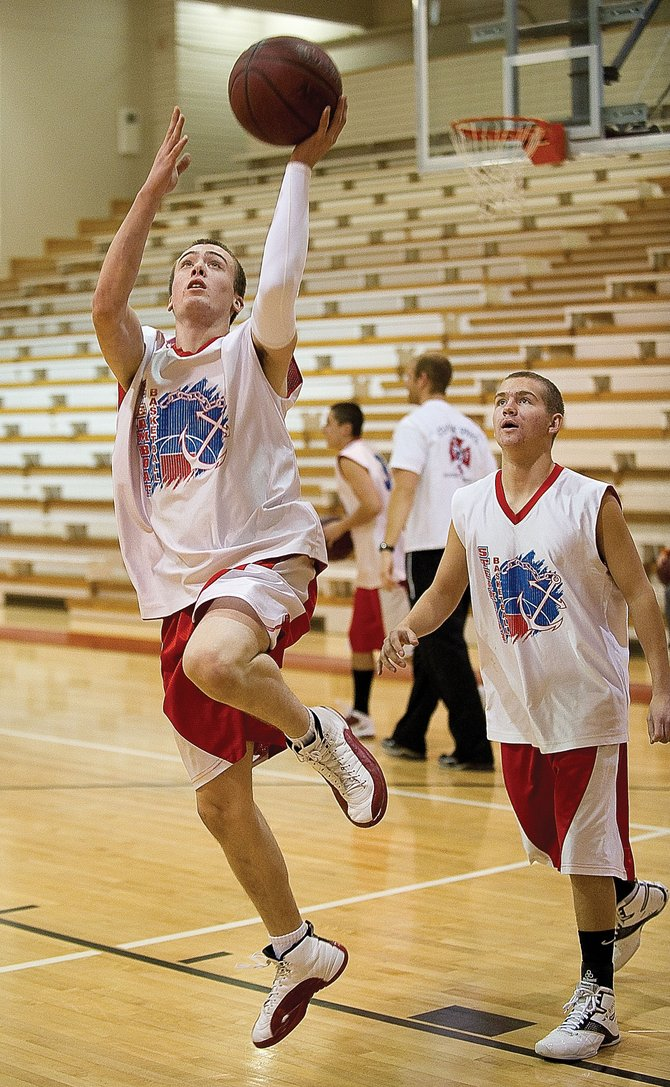 Steamboat Springs High School senior Hondo Anderson, front, and Justin Anderson run through drills during practice Wednesday afternoon. The team is preparing for the Flaming Gorge Classic 2010 invitational basketball tournament, which begins today in Green River, Wyo.