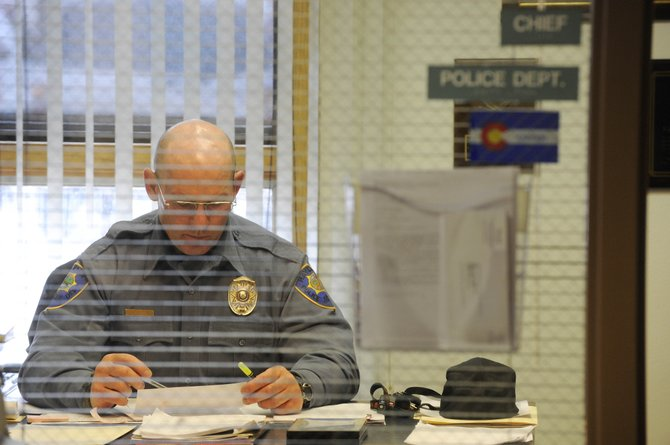 Hayden Police Chief Ray Birch works at his desk inside Hayden Town Hall in 2009. Birch, who became Hayden's police chief in December 2006, has accepted the position of Routt County undersheriff.